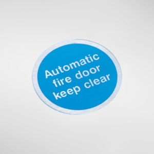 8447S Modric Self Adhesive 'Automatic fire door keep clear' Sign