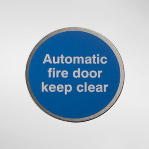 98947 Alite Circular Self Adhesive 'Automatic Fire Door Keep Clear' Sign